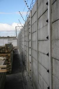 Piggy back electric fencing on a Vibracrete Wall